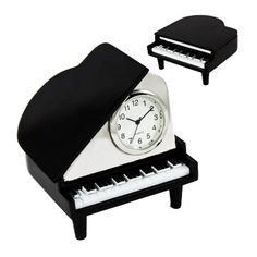 Grand piano novelty metal clock. Clock folds inside piano when not in use.