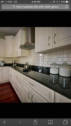 Kitchen Backsplash Ideas With Black Countertop Below Food Canisters Set  Alongside Stainless Steel Whistling Kettle Over Glass Induction Cooktop