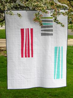 minimalist quilt with free hand cut strips
