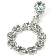 Sterling Silver Sky Blue Topaz Gemstone & AAA CZ Accents