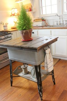Magazine Your Home blogger Teresa gave the washtub a new life as a rustic island would look at home in any country kitchen. Bonus: The addition of a vintage wood tray to the bottom area acts as a handy display shelf for storing cookware. Find out more about this makeover.