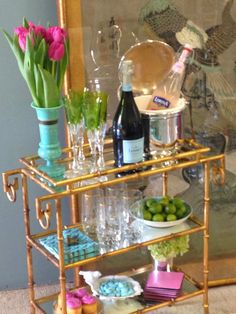 This bar cart is styled with fun finds from HomeGoods like the bird bowl. It has a dainty look and perfect for hosting a fun get together.
