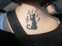 cat music tattoo. good idea, but i like maybe having the treble clef looking like a ball of yarn...