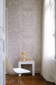 Hallelujah (TP 183) by Elitis, a large-scale projection of delicate lace paper on the wall.  http://www.elitis.fr/en/papiers-peints/papier-peint-/collection-pleats_473.php?d=30