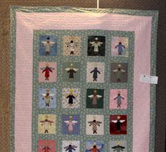 Another angel quilt.  See my comments on the other angel quilt. http://www.newbraunfelsareaquiltguild.org/images/Show%20&%20Tell%20September%2009/IMG_1797_DebraBaker_AngelQuilt.jpg