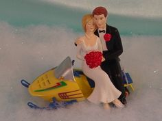 Snowmobile caketopper--- Dan and I totally needed this when we got married!