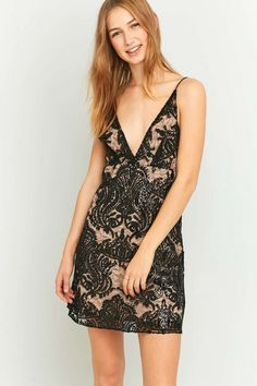 251fc872831522 Shop Free People Night Shimmer Black Mini Dress at Urban Outfitters today.