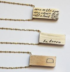 Now that's solid: you can order a brass bar pendant adorned with any (short) quote, name, or initial you please. #etsyfinds