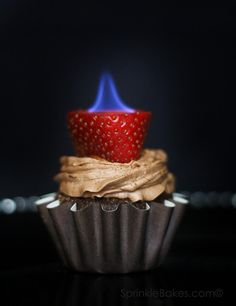 The strawberries are hollowed out and filled with a bit of liquor, then ignited with a match. The cupcakes make a fun, different dessert.