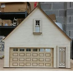 Made in the USA from Baltic birch plywood garage/workshop kit in scale. Includes 16 x 7 inch working garage door, working windows and door. Dollhouse Design, Dollhouse Kits, Wooden Dollhouse, Wooden Dolls, Dollhouse Furniture, Outside Toilet, Toy Garage, Toy House, House Built