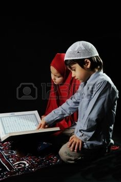 Muslim kids reading holy koran on  black background