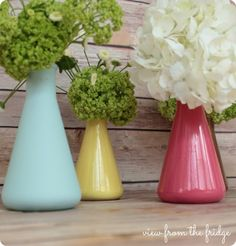 spring vase from Erlenmeyer Flasks! Katie purchased two 'variety' packs off Amazon for $6.99 each, spray painted them some fun, spring colors
