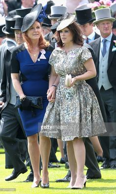 Princess Eugenie and Sarah Ferguson hold hands in the parade ring on day 4 of Royal Ascot at Ascot Racecourse on June 19, 2015 in Ascot, England.