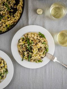 This vegan spring recipe for asparagus risotto is made with quick cooking orzo, leeks and mushrooms. Paired with a light and crisp white wine, it's a deliciously no fuss dinner. #vegan #vegetarian #springrecipe #risotto #veganrecipe #dinner via @theseasonedveg