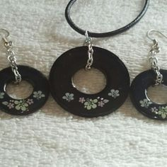 @KyDanJenjewelry Black #wearableindustrialart necklace & earring set with flowers. Hand painted. Length is 18in on leather cord with spring ring clasp. from KyDanJenjewelry for $25.00 on Square Market