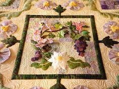 Amazing!!  Margie Kraft quilted this applique wonder done by Deana Steel, who added applique and dimensional flowers to pieced blocks she had won.