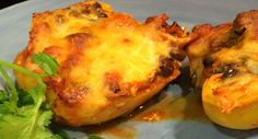This was so good that my carnivorous husband didn't even mind that it was vegetarian! This healthy dish combines the delicious taste of enchiladas withstuffed peppersand trust me, you're going to LOVE it! It's a taste sensation.  Ingredients:  4 yellow peppers (you can mix it