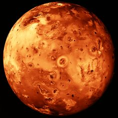 Jupiter's moon Io is 778 million kilometers from the Sun. Except at its volcanic hot spots, Io's surface temperature is well below freezing. Instruments aboard the space probe Galileo measured infrared energy emitted by volcanic hot spots on the satellite's surface. Io was found to have at least 12 active volcanoes erupting lava at temperatures over 1200 degrees Celsius.