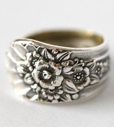 Adorn your paws with this spoon ring, reshaped from vintage silverware. Flowers bloom around the entire band, framed by a ridge on either side. Patinaed from use, the natural tarnish on the spoon accents the small details on each leaf and petal.