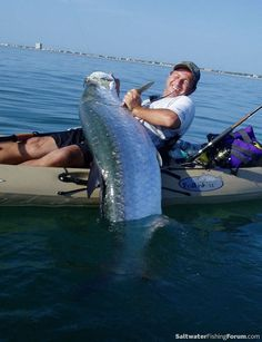 Fishing for tarpon in the surf from a kayak.