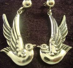 With a textured three dimensional depth, this Margot de Taxco earring mold was masterfully reproduced by Melesio Rodriguez. The earrings are beautiful birds hand wrought from a superior 950 silver.