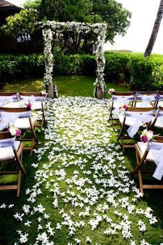 outdoor wedding ceremony white floral altar - real wedding photo by John and Joseph Photography
