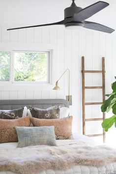 Covering up ugly wood paneling, painting it white quickly brightens up a space and gives the boards a cute cottage vibe.