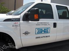 Simple door lettering that is clear to read brands a fleet truck for Environmental Noise Control.