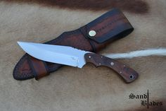N690 OAL 255mm Blade length 136mm Weight 182g Satin finish Tamboti S/S pinning + Mosaic Tapered tang Blue liners Vine spine filing work Two-tone brown cowhide sheath, 3-way carry  For any inquiries  sandtcustomblades@gmail.com  Follow us on Facebook  @SandtCustomBlades
