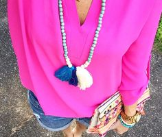 A touch of #turquoise + #tassels looks preppy chic combined with #pink; the Wood Bead Tassel Necklace by SwellCaroline.com is a season-perfect #statement! {photo cred: Peaches in a Pod}
