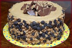 Hugs & CookiesXOXO: REESE'S OVERLOAD CAKE-2 PEANUT BUTTER BLONDIE LAYERS, 1 CHOCOLATE CHEESECAKE LAYER FILLED WITH AN INTENSE CHOCOLATE FROSTING, TOPPED WITH PB FROSTING