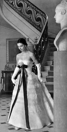 1956 Jacky Mazel in a summer evening gown by Maggy Rouff,
