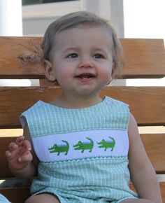 Frogs, snails and alligator tails, that is what little boys are made of. Love this smocked alligator jon jon!