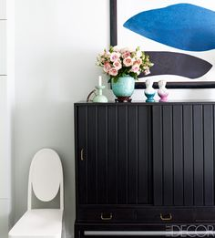 A painting by Philippe Garouste de Clauzade hangs above a console by Axel Einar Hjorth in the bedroom; the circa-1911 chair is by Otto Prutscher. For details, see Resources.   - ELLEDecor.com