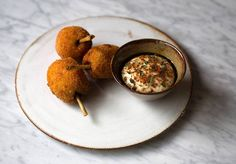 """Our Rustic Round Platter here being used to serve Chicken wing """"drumstick"""" with garlic liquor at the Typing Room."""