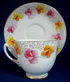 Roslyn China - Vintage Art Deco Tea Cup And Saucer - handpainted Sweet Pea flowers-  Pink & Yellow, gold edge -  1930s - ex antiquesandteacups.com