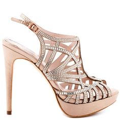 Jaws will drop when you arrive in the Janene.  This elegant sandal by Vince Camuto features a light beige satin upper with stunning bead design and shimmery stones.  Straps create a unique vamp for an eye catching looking while a 5 inch heel and 1 inch platform don't fail to impress.