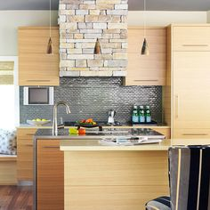 Turn It Sideways - Running the wood grain of these white oak cabinets horizontally lends a loft-like urban style to this sleek, modern kitchen.