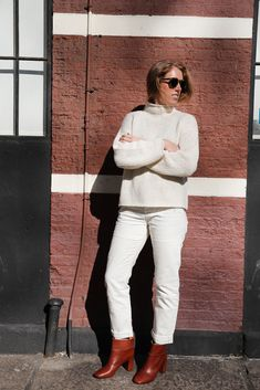 I go hard for monochrome. Also, if you are sick of the neck brace lewk and can't commit to the full turtle, consider the mock neck.  J.Crew sweater, Madewell jeans, Chloé shoes, Illesteva sunglasses.