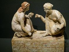 Two young women playing knucklebones Greek 330-300 BCE said to be from Capua, Italy   Flickr - Photo Sharing!