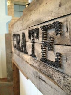 Random but love this idea! spell a word w groupings if screws or nails ! rustic