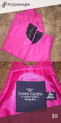 Pink and black snow pants with bib Pink snow pants with black accents. Like new. Faded Glory Other