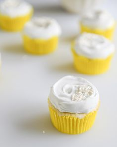fluffy lemon cupcakes with whipped coconut cream.