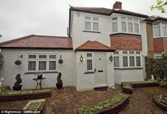 Typical family home: This four bedroom property in Hillingdon, Middlesex, looks unimposing and traditional from the outside