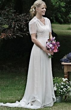 Vintage wedding dress with A-line silhouette and v-neck. Short sleeves provide coverage for skin. Made of chiffon. Free made-to-measurement service for any size. Available colors seen as in Color Options.