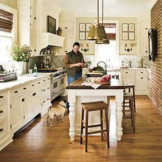 Traditional white farmhouse kitchen with marble and wood countertops from Southern Living magazine - love this!