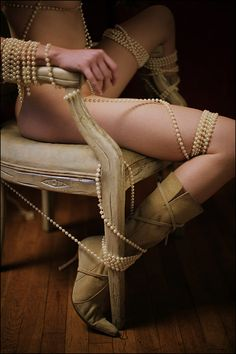 I love the sensuality of pearls on a woman's skin. In this case she is bound with them.
