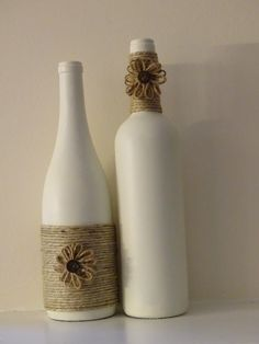 Pair of painted white wine bottles with twine and twine flowers by TwinenWineCreations on Etsy