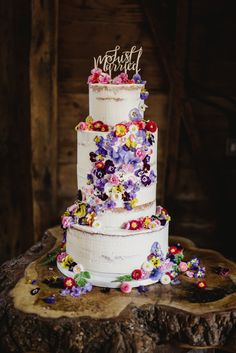 Semi-naked wedding cake with cascading fresh edible flowers from Maddocks Farm Organics.