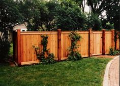 Wood fence ideas - Tight Slat with Top and Bottom Border Board and Cap Board on Top. Capped Higher posts lend a more elegant feel